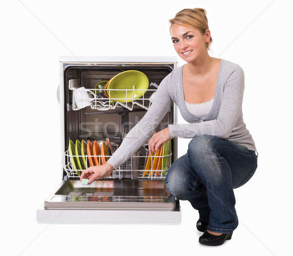 Young Woman Placing Soap In Dishwasher Stock photo © AndreyPopov
