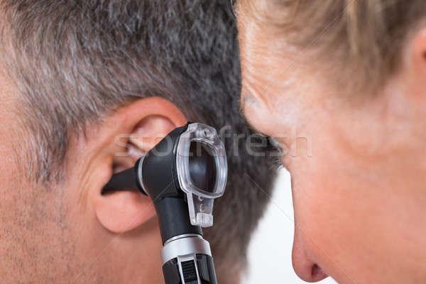 Doctor Examining Patient's Ear Stock photo © AndreyPopov