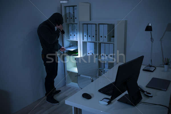Robber With Flashlight Searching For Documents In Office Stock photo © AndreyPopov