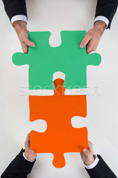 Cropped Image Of Businessmen Assembling Jigsaw Puzzle Stock photo © AndreyPopov