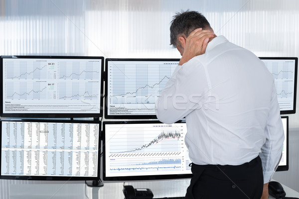 Stock Market Broker Suffering From Neck Pain By Multiple Screens Stock photo © AndreyPopov
