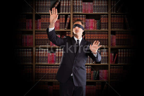Blindfolded Lawyer Gesturing In Office Stock photo © AndreyPopov
