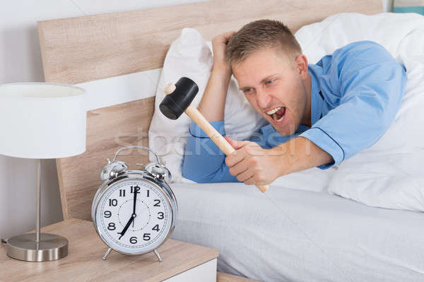 Man Smashing Alarm Clock With Hammer Stock photo © AndreyPopov