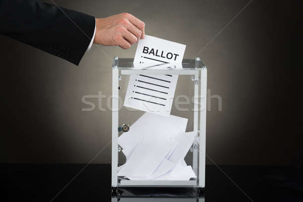 Businessperson Hand Putting Ballot In Glass Box Stock photo © AndreyPopov