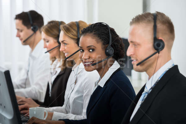 Businesswoman Working With Other Colleagues In Call Center Stock photo © AndreyPopov