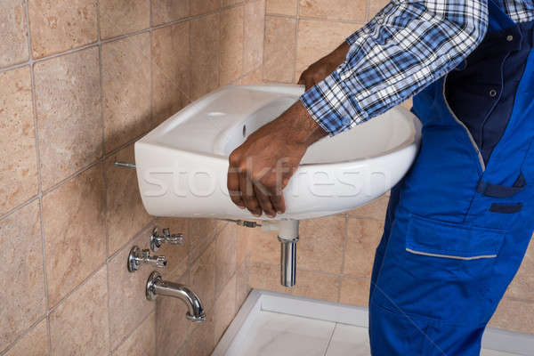 Handyman Fixing Sink In Bathroom Stock photo © AndreyPopov