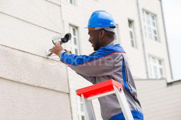 Technician Repairing Surveillance Camera Stock photo © AndreyPopov