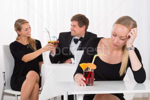 Deprimido mujer sesión restaurante Pareja Foto stock © AndreyPopov