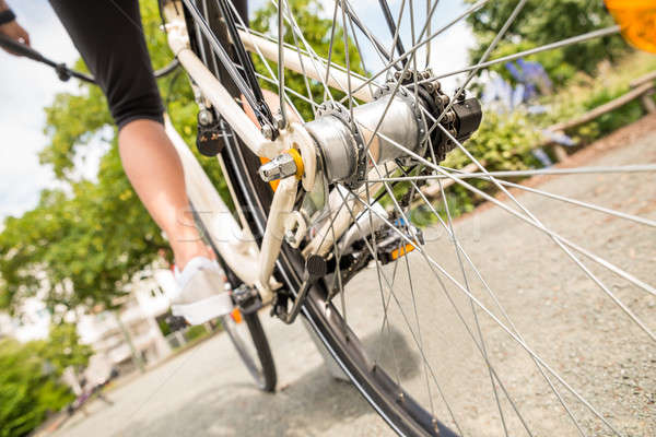 Close-up Of A Woman's Leg Peddling Bicycle Stock photo © AndreyPopov