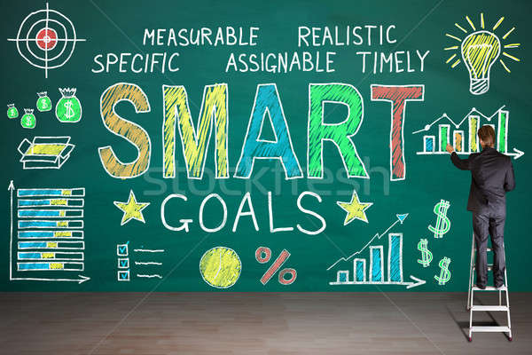 Businessperson Drawing Smart Goals Concept On Blackboard Stock photo © AndreyPopov