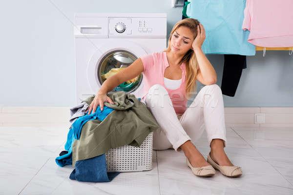 Infeliz mulher olhando roupa utilidade quarto Foto stock © AndreyPopov