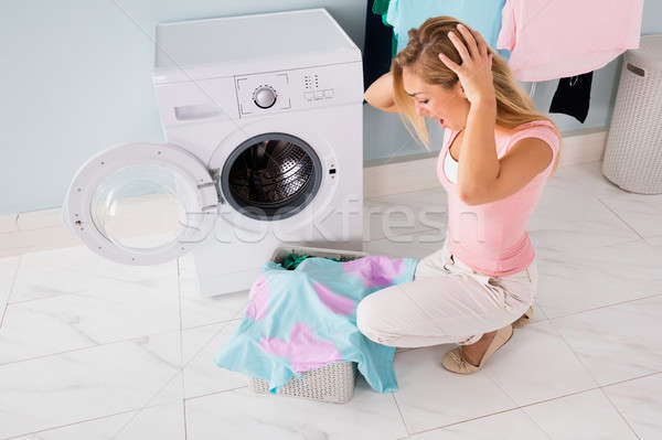 Shocked Woman Looking At Stained Clothes Stock photo © AndreyPopov