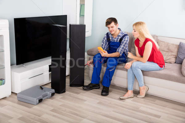 Male Technician Checking TV Speaker With Multimeter Stock photo © AndreyPopov