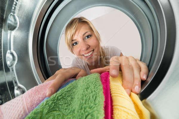 улыбающаяся женщина одежды стиральная машина молодые женщину Сток-фото © AndreyPopov