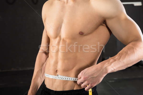 Person Measuring Waist Using Measuring Tape Stock photo © AndreyPopov
