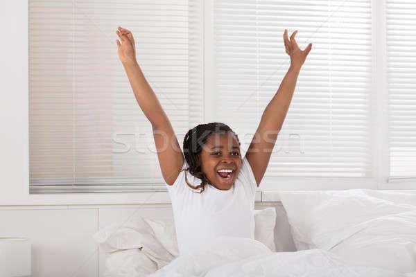 Happy Girl Waking Up Stock photo © AndreyPopov