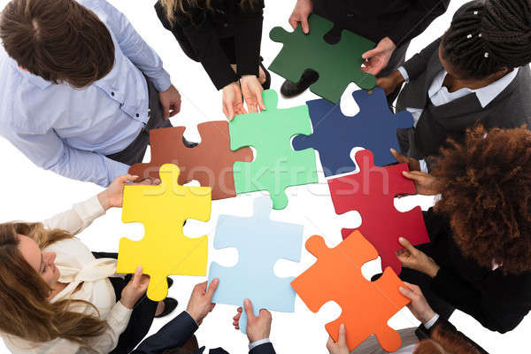 Businesspeople Solving Jigsaw Puzzle Stock photo © AndreyPopov