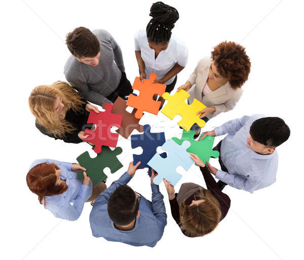 Group Of College Students Solving Puzzle Stock photo © AndreyPopov