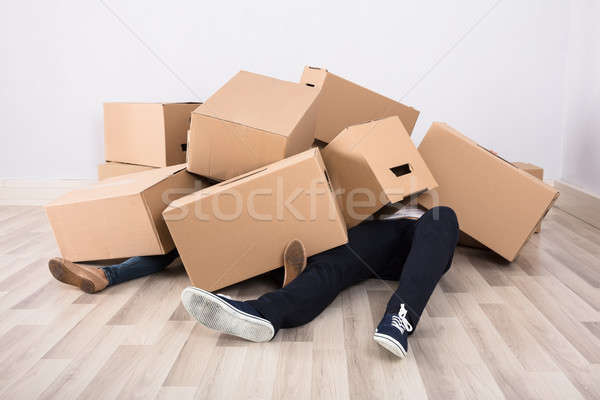 Couple Lying Under The Cardboard Boxes Stock photo © AndreyPopov