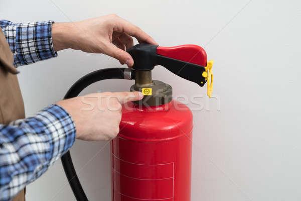 Kéz mutat szimbólum piros tűzoltó készülék közelkép Stock fotó © AndreyPopov