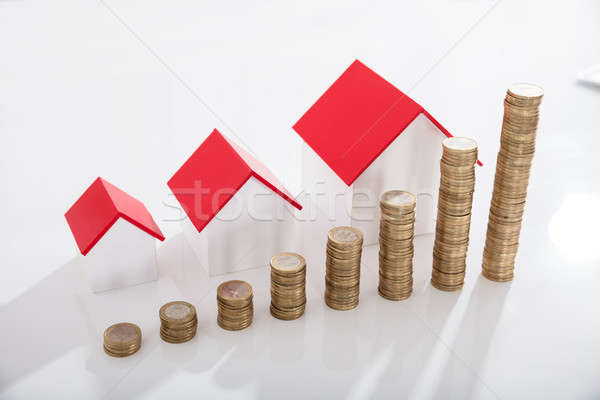 House Models And Stack Of Coins Stock photo © AndreyPopov