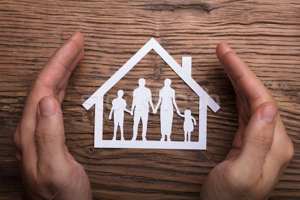 Person Holding Protective Hand On Family Home Stock photo © AndreyPopov