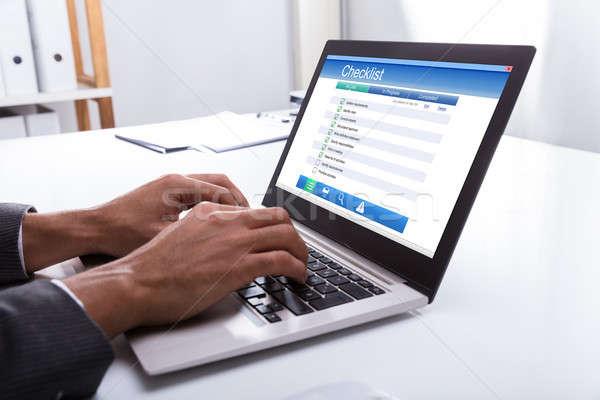 üzletember tömés lista űrlap laptop közelkép Stock fotó © AndreyPopov