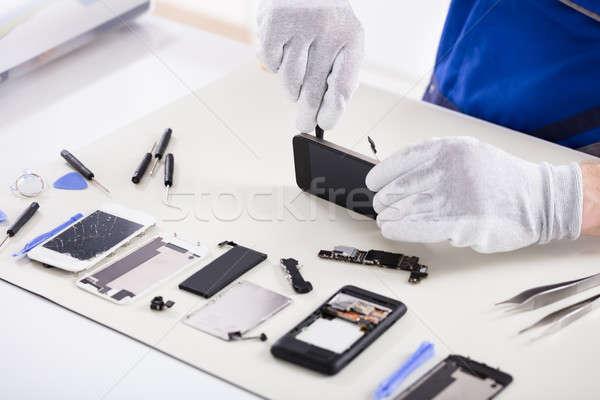 Human Hand Repairing Smartphone Stock photo © AndreyPopov