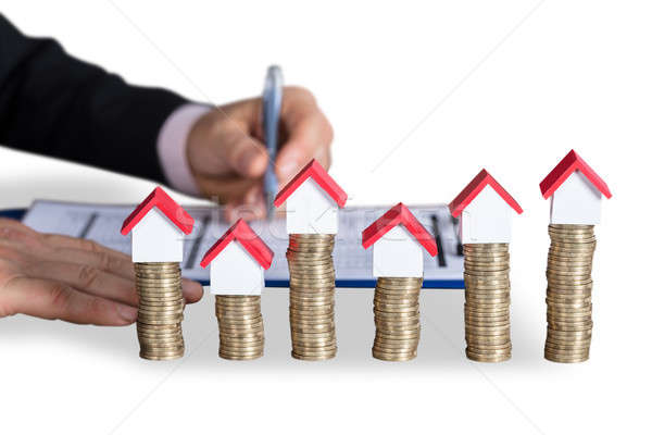 House Model On Top Of Stacked Coins Stock photo © AndreyPopov