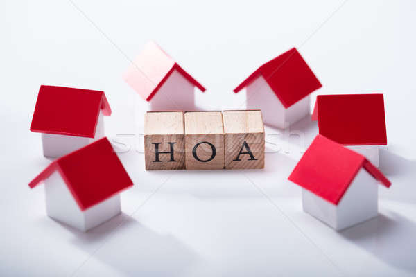 Homeowner Association Wooden Block Surrounded With House Models Stock photo © AndreyPopov