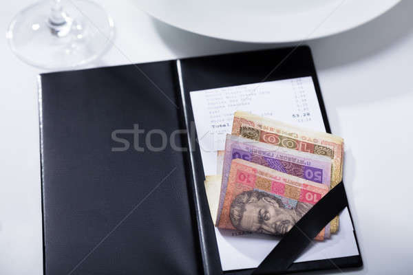 Bill With Ukrainian Banknotes In Folder Payment On Table Stock photo © AndreyPopov