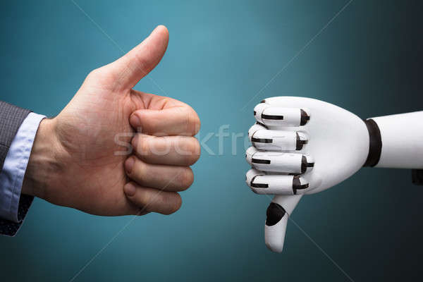 Businessperson And Robot Showing Thumb Up And Thumb Down Sign Stock photo © AndreyPopov