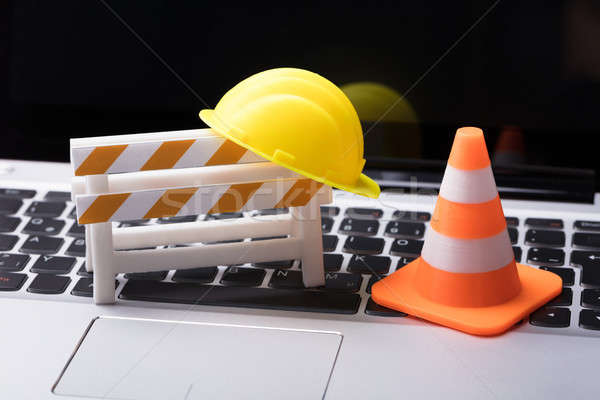 Road Barrier With Hard Hat And Traffic Cone Stock photo © AndreyPopov