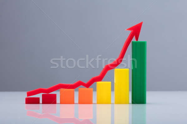 Multi Colored Business Graph With Arrow Sign Stock photo © AndreyPopov