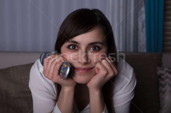 женщину телевидение пультом портрет Сток-фото © AndreyPopov