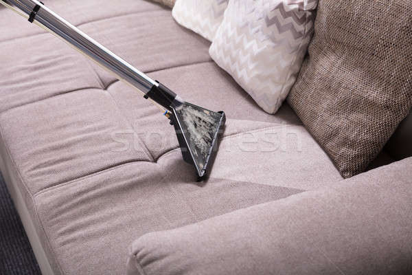 Close-up Of Vacuum Cleaner On Sofa Stock photo © AndreyPopov