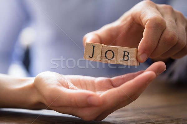 Businessperson Giving Wooden Block With Job Text To Candidate Stock photo © AndreyPopov