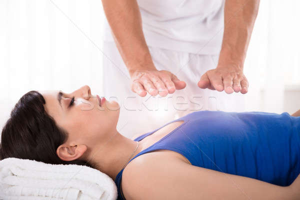 Woman Having Reiki Healing Treatment Stock photo © AndreyPopov