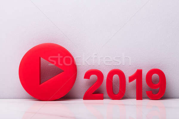 Red Play Icon Near Year 2019 Stock photo © AndreyPopov