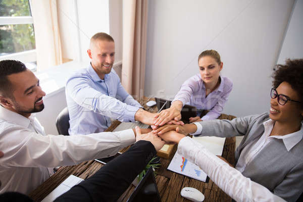 Young Businesspeople Stacking Hands Stock photo © AndreyPopov