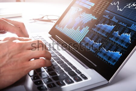 Businessman Monitoring CCTV Camera Footage On Laptop Stock photo © AndreyPopov