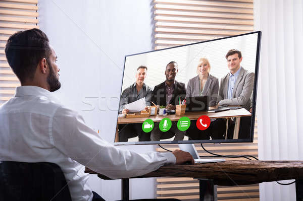 Businessman Video Conferencing With His Partner On Computer Stock photo © AndreyPopov