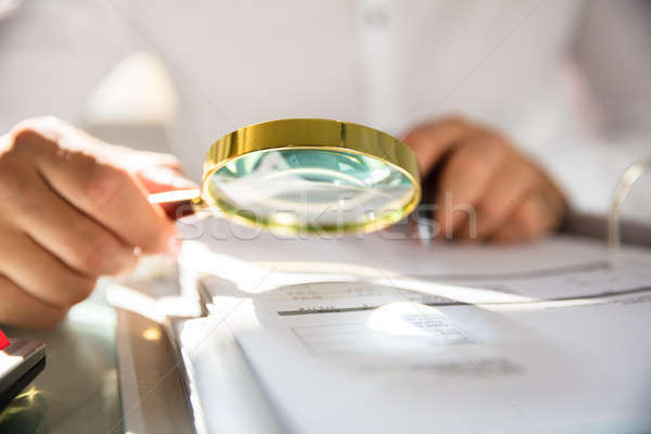 Imprenditore bill lente di ingrandimento ufficio business Foto d'archivio © AndreyPopov