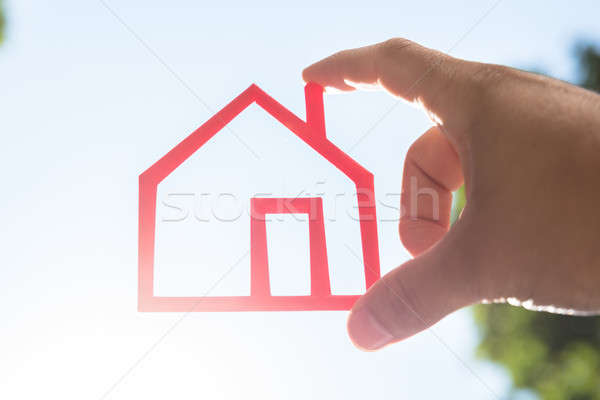 Human hand holding house model Stock photo © AndreyPopov