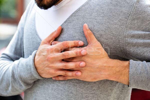 Adam göğüs ağrı el Stok fotoğraf © AndreyPopov