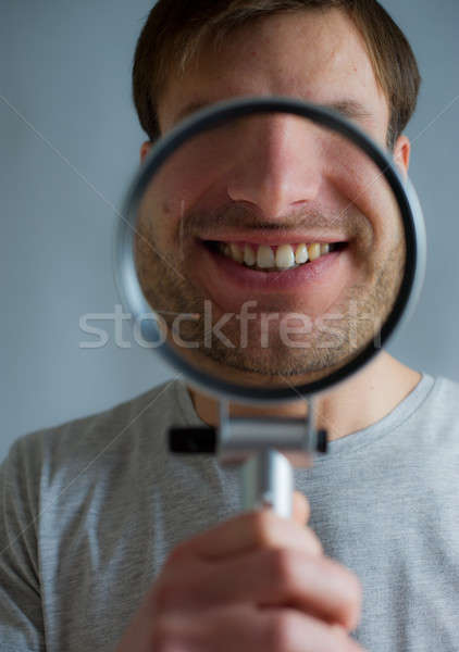 guy with magnifying glass Stock photo © Andriy-Solovyov