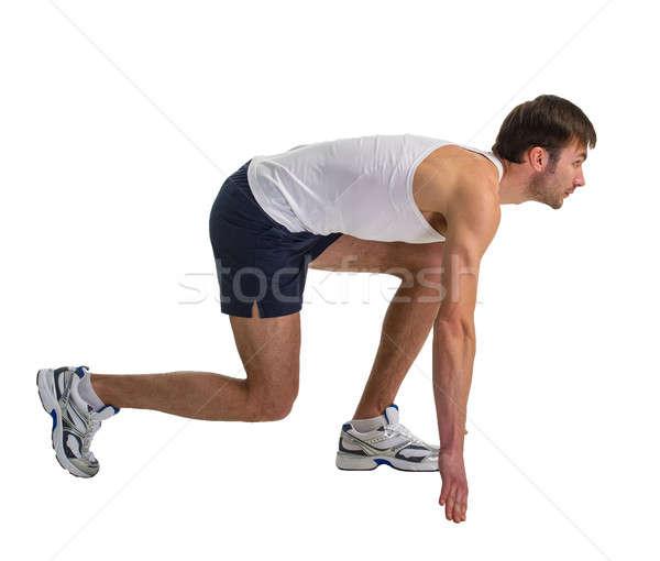 Atlet erkek egzersiz yalıtılmış beyaz Stok fotoğraf © Andriy-Solovyov