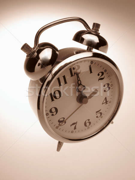 Alarm-clock on light background Stock photo © Andriy-Solovyov