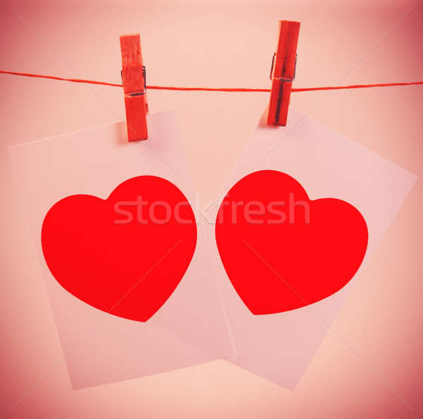 Two photos on a rope symbol Valentine pinned clothespins, closeup  Stock photo © Andriy-Solovyov