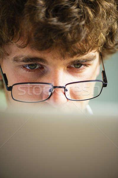 бизнесмен очки молодые энергичный за Сток-фото © Andriy-Solovyov